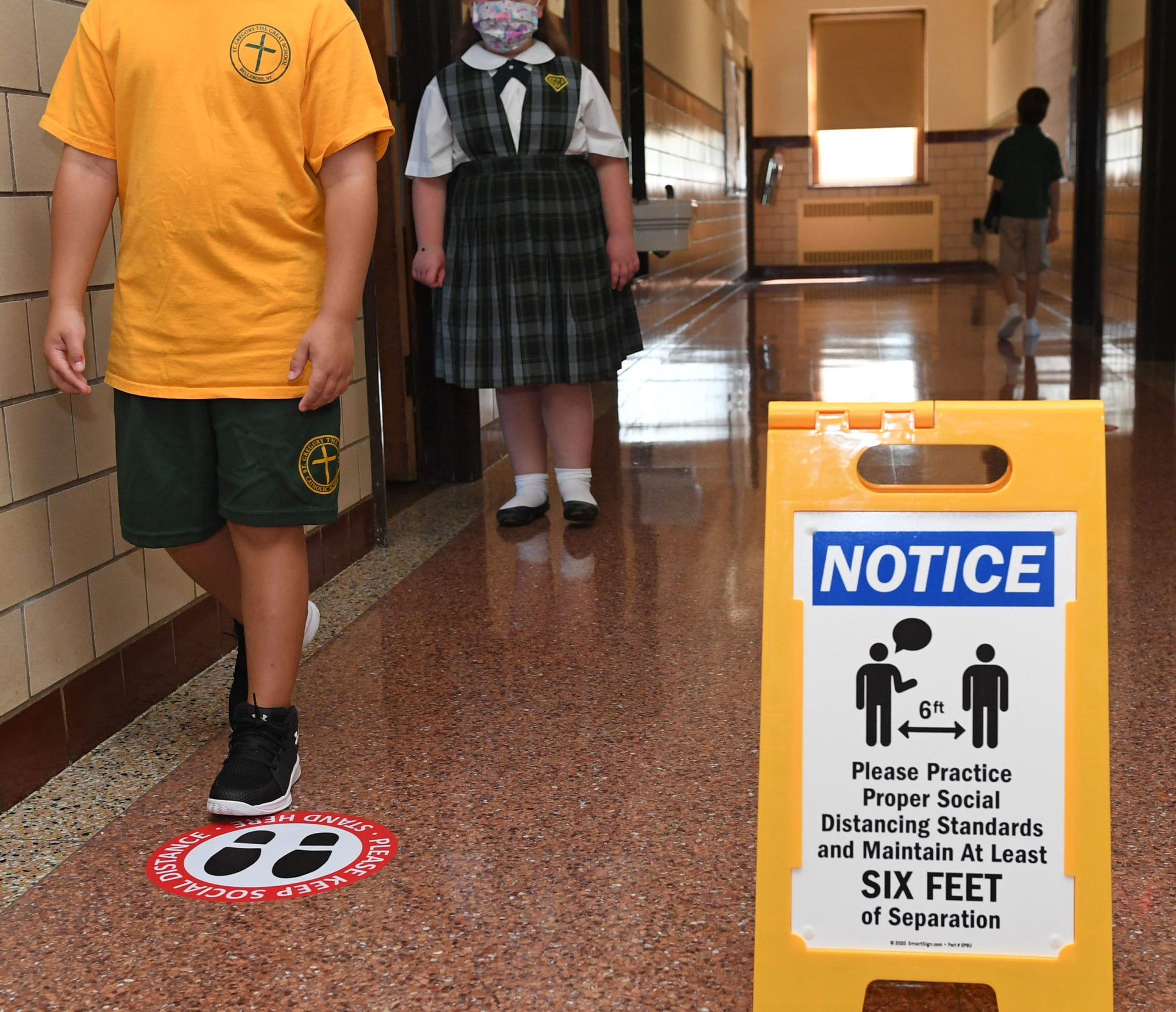 Children Walking In Hallway Wearing Masks and Social Distancing